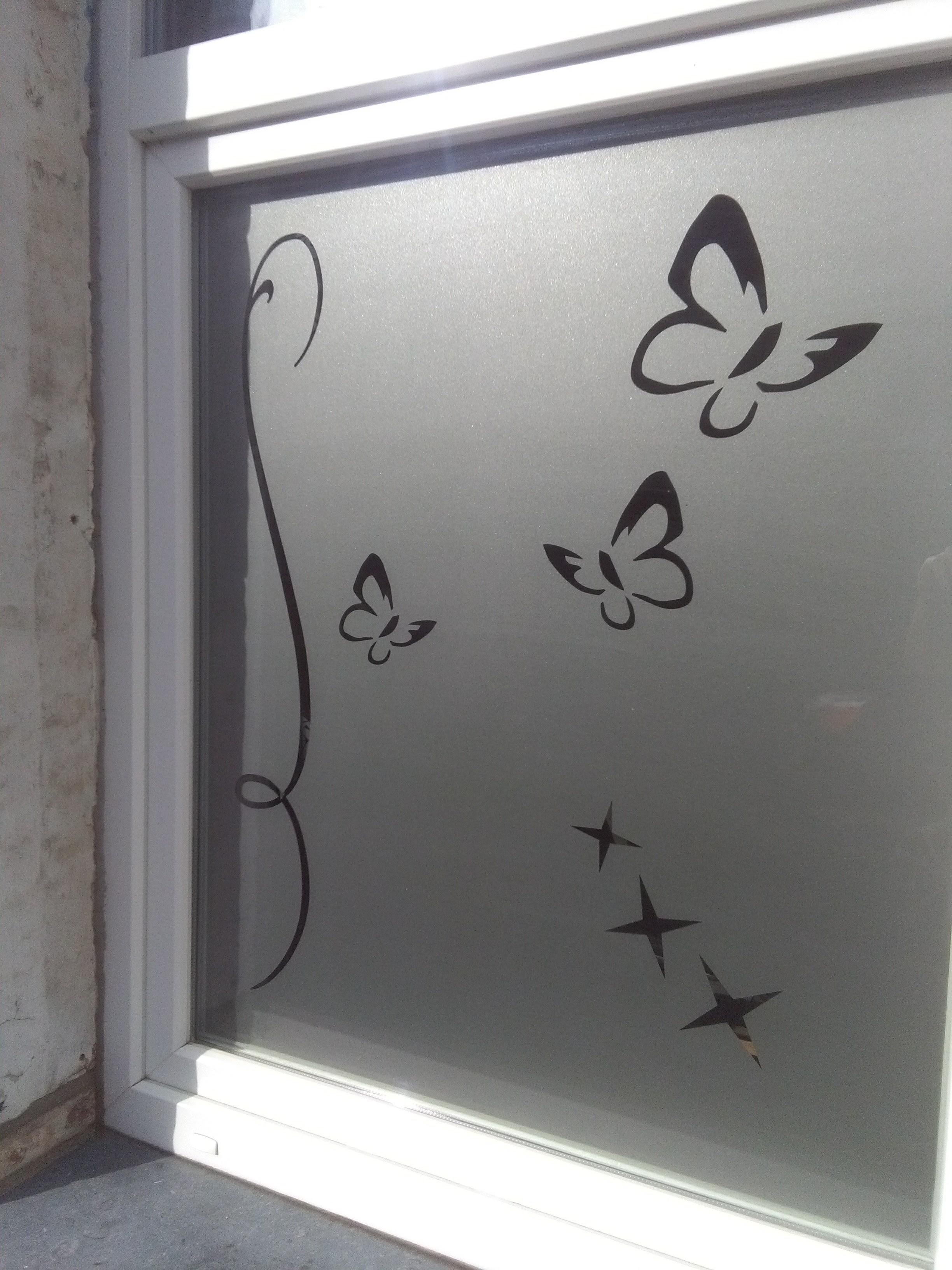 sablage de vitre avec film